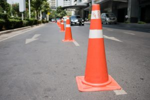 Traffic management cones on a street.